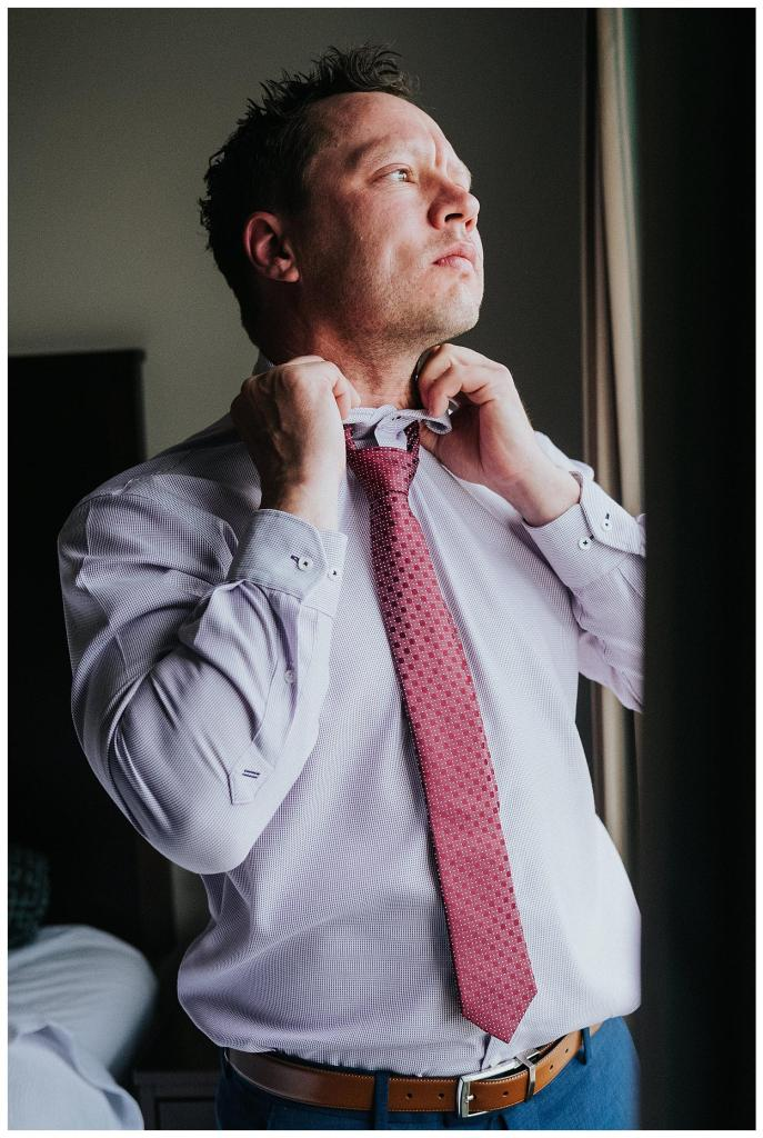 Groom straightening out his tie | Hanover Wedding