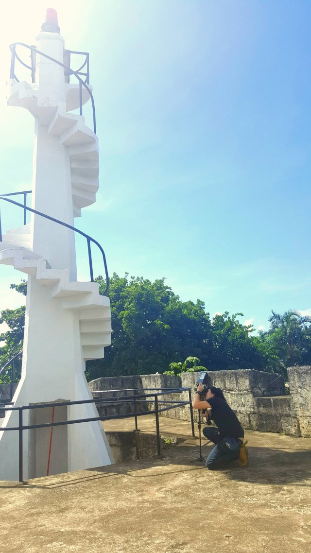 Me in my all-out effort to take a photo of the The Lighthouse of the Fuerte De La Concepcion Y Del Triunfo of Cotta Fort in Ozamiz City