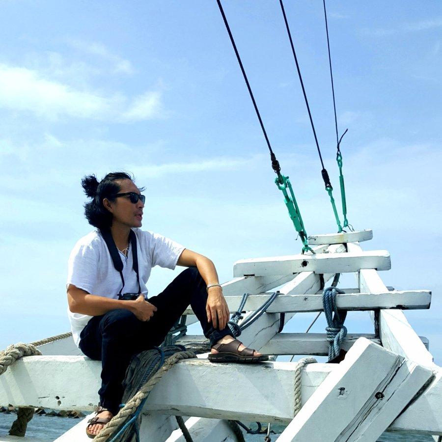 Me on board a kapal finisi or traditional inter-island cargo ship off the coast of Sunda Kelapa Harbour, Jakarta, Indonesia