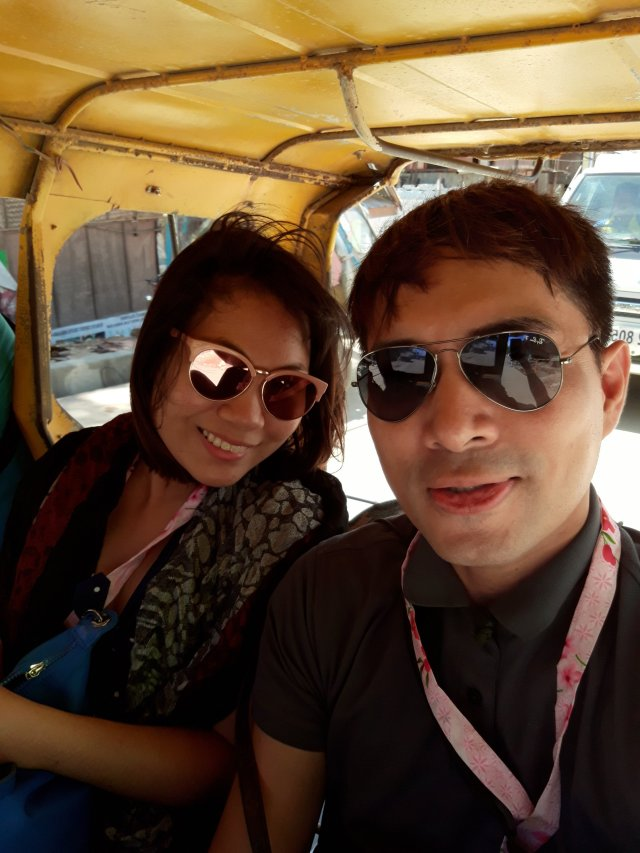 Tricycle ride with a new friend from Caticlan Airport to the Caticlan Jetty Port