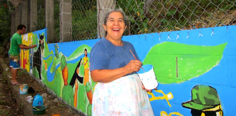 Erika's mother gave an oral history to the group, which greatly informed the design. She also wrote poetic passages that were used throughout the mural.