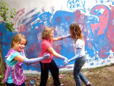 it must be universal-- kids all over the world end up painting themselves as well as the wall!