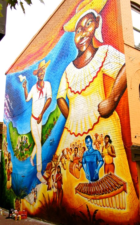 """""""Currulao y Desplazamiento: The Afro-Colombian Mural"""" on U Street in DC, designed by local Afro-Colombians who have asylum in the US due to the armed conflict on the Pacific Coast of Colombia. Funded by the DC Commission on the Arts & Humanities"""