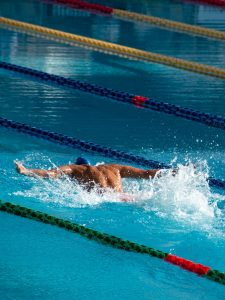 men swimming butterfly better with sports performance coaching