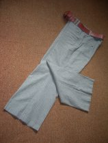 grey pinstrip trousers & pink belt