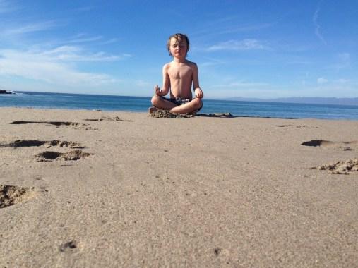Meditating on the beach...strange child