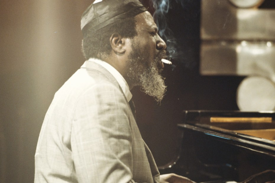 Thelonious Monk Smokes a Cigarette while playing the piano