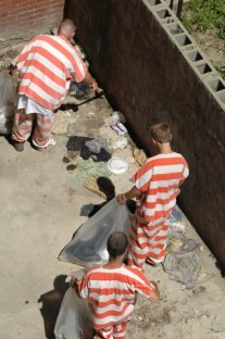 Hamilton County Justice Center inmates clean up an alley in Over-the-Rhine