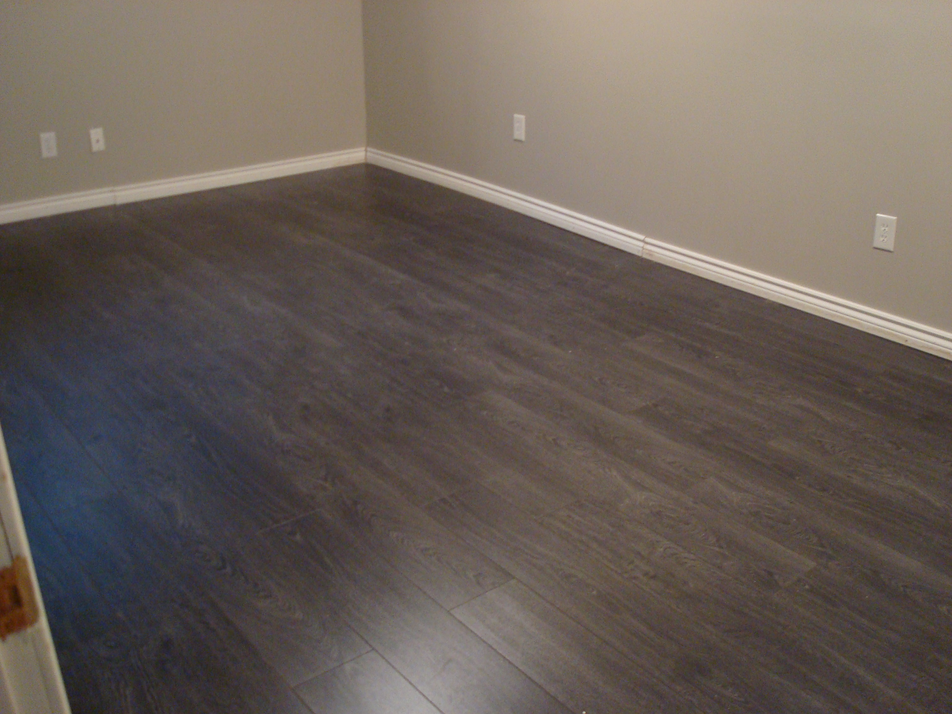 Laminate flooring in the basement  Joey  Janice buy a house