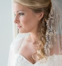 Bride looking out of a window in her wedding dress, harbour hotel, st ives, cornwall