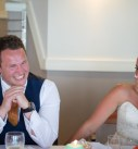 Groom laughing at speech at the harbour hotel in St Ives at his wedding