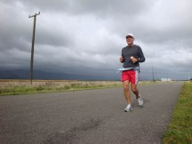 Gerry, approximately 5km from the finish with some threatening clouds on the way.