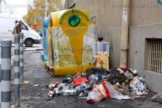 Pile of rubbish beside recycling containers in central Sofia