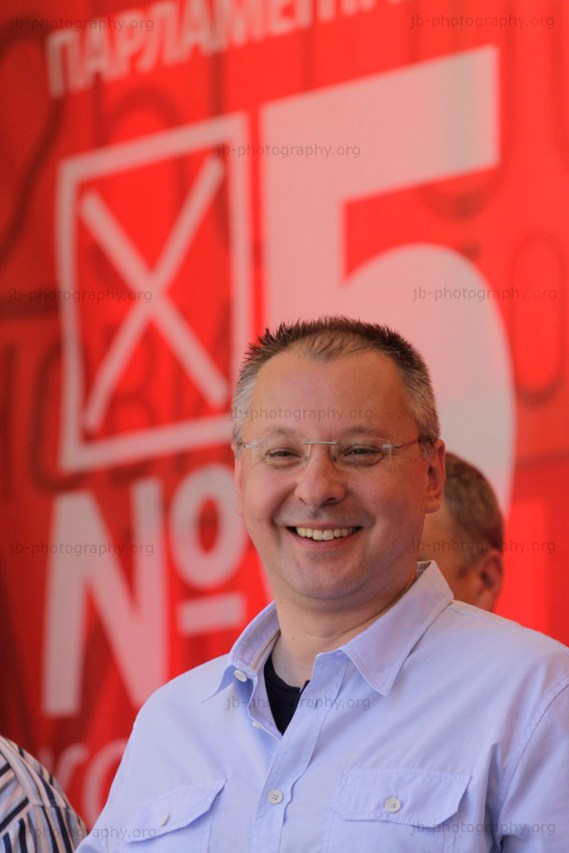 Socialist party leader Sergey Stanichev on the podium in front of an election poster