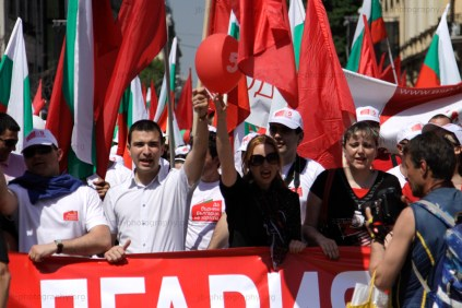 Demonstrators chanting slogans during the Labor Day march through central Sofia
