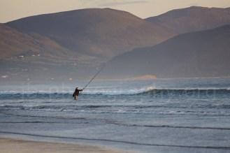 Sea angler in the surf on Inch Strand, Dingle Peninsula (© Johann Brandstätter Photography)