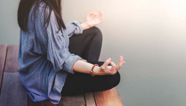 young-woman-practices-yoga-outdoor-sitting-lotus-position-unplugged-life-mental-health-concept_34048-661