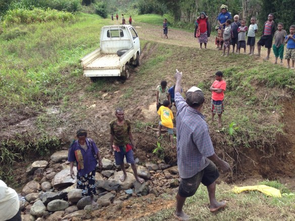 Heavy rains regularly tear up our bush road, and we are the ones who get to fix it. (Mte village, Nov. 2015)