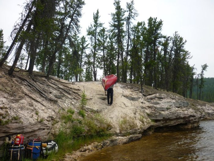 John and 'Big Red' tackle the Upper Manitou Rapids portage