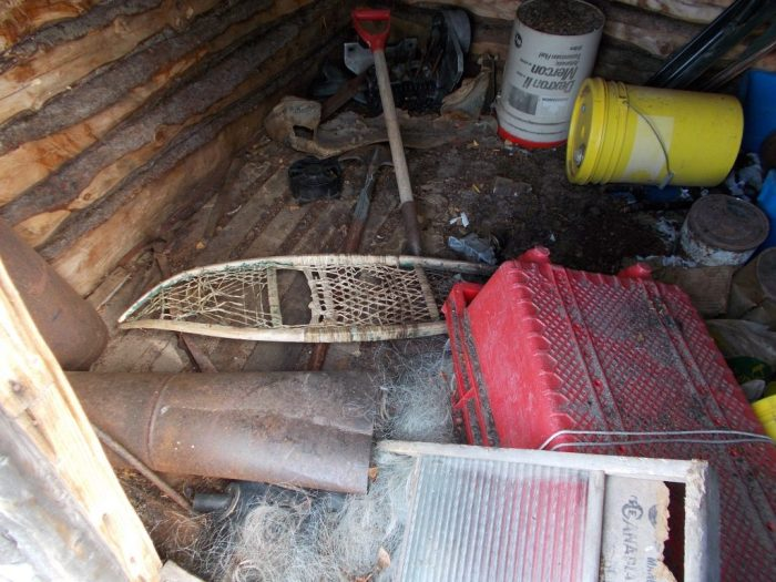 Gut webbed snowshoes, a washing board, fishing nets and fish bins all left awaiting an owner who would never return