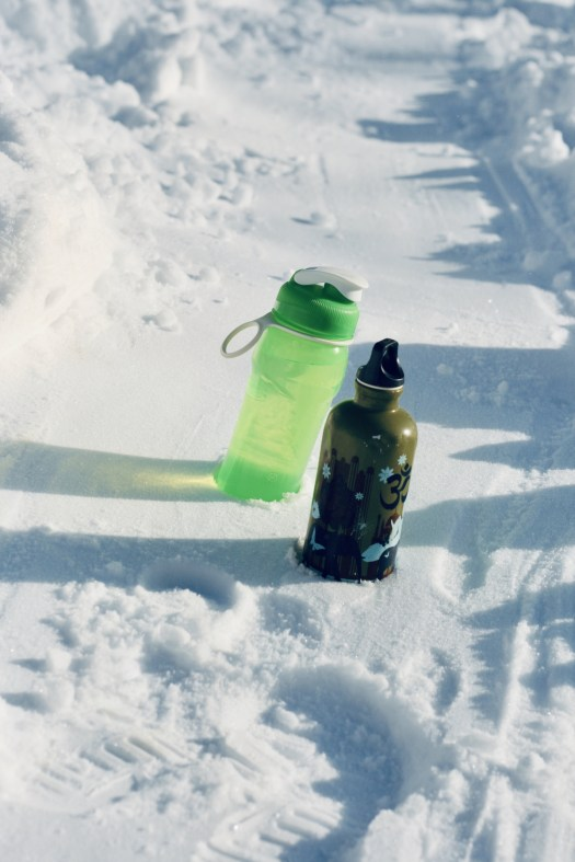 water bottles in the snow