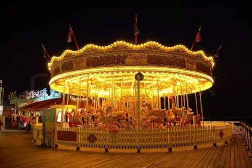 3847812-carousel-illuminated-at-night