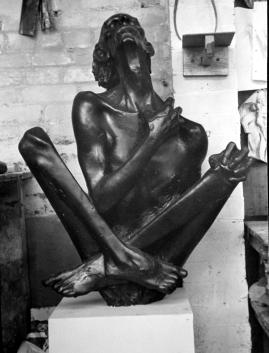 Crossed legged figure