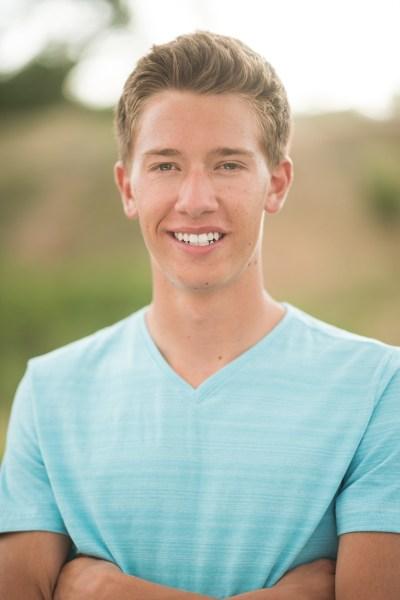 Denver high school senior photo smiling in field