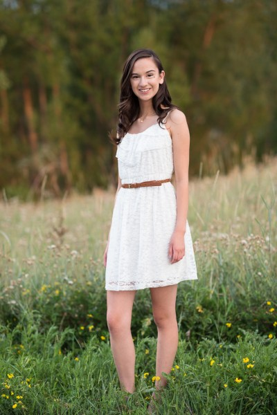 high school senior girl in a field