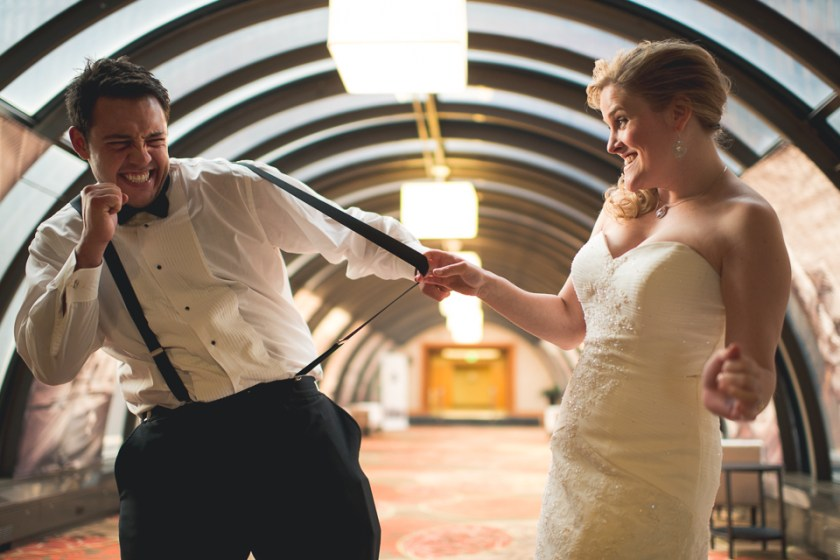 downtown denver wedding photography bride snaps suspenders