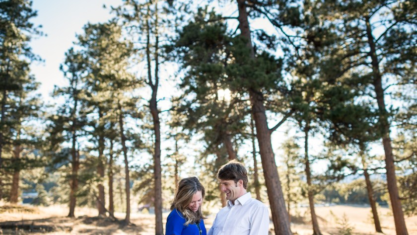 evergreen engagement photos in a backlit forest
