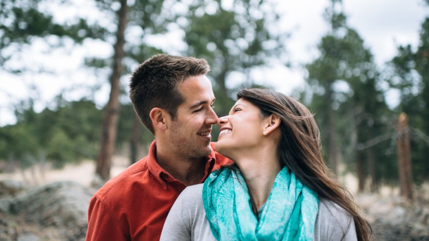 Evergreen engagement photography happy couple in a forest