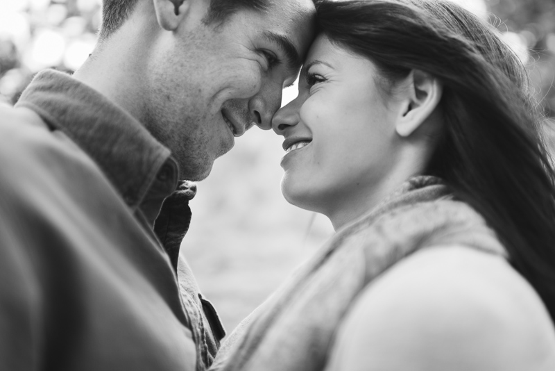 Evergreen engagement photography happy couple in a forest black and white