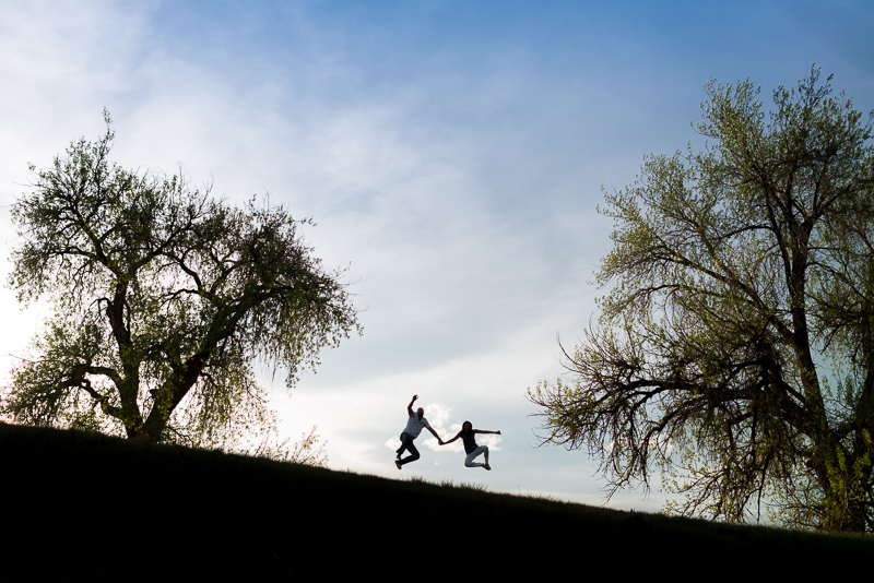 Denver Engagement Photography silhouette couple jumping