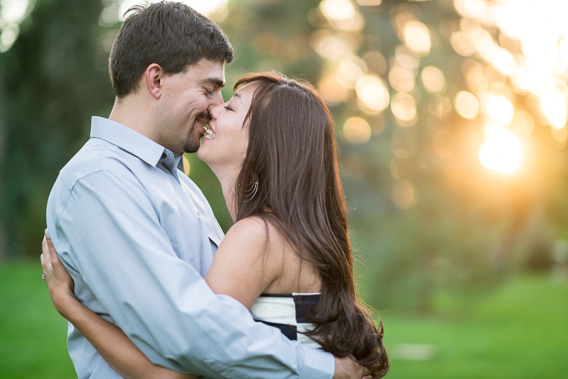 Denver Engagement Photographer kissing sun drenched couple