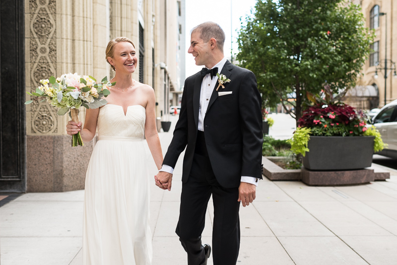 Denver Opera House Wedding Photographer bride and groom walking laughing