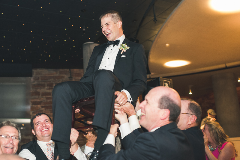 Denver Opera House Wedding Photographer groom on chair