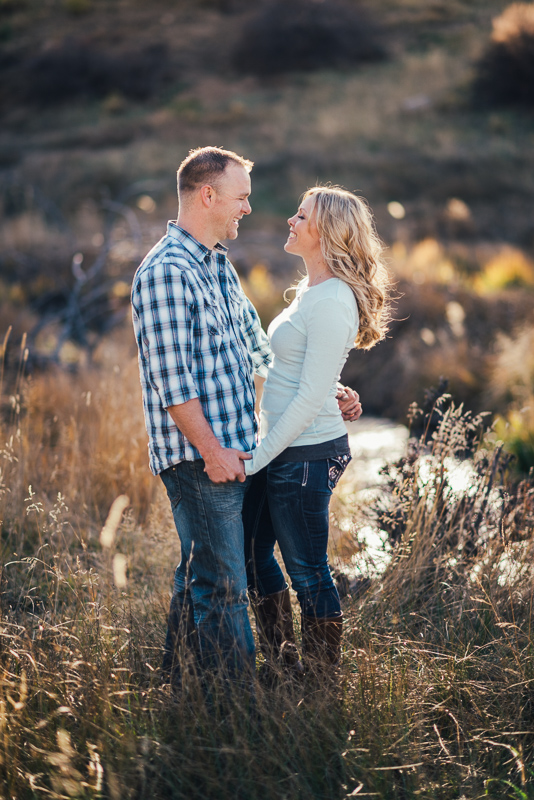 Denver Engagement Photographer couple in field with stream