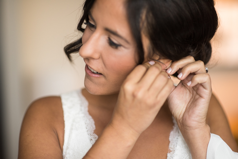 Denver Wedding Photography History Colorado bride putting on earrings