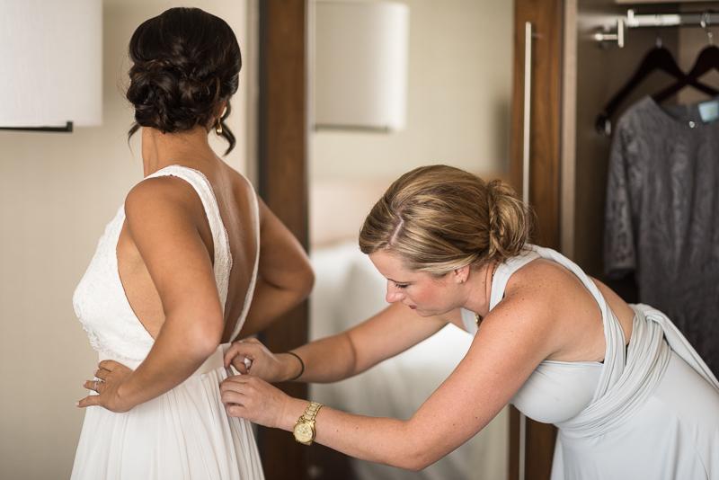 Denver Wedding Photography History Colorado bride getting into dress