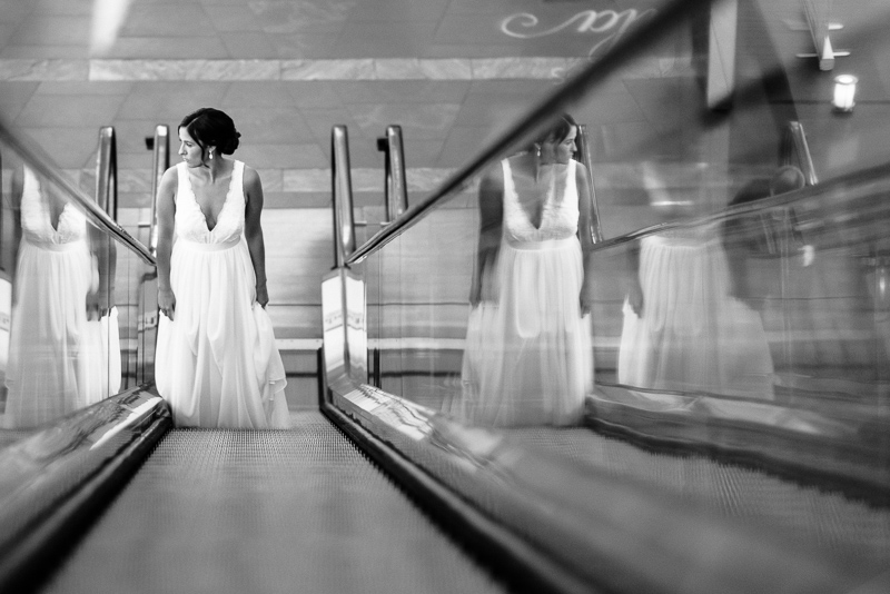 Denver Wedding Photography History Colorado bride on escalator