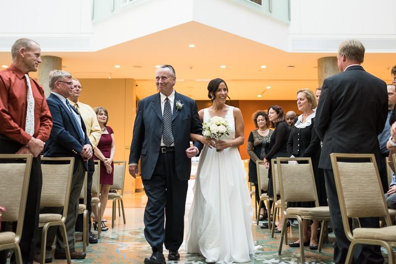 Denver Wedding Photography History Colorado bride walking down aisle