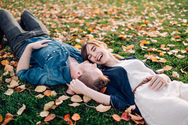 Denver engagement photography laughing in fall leaves