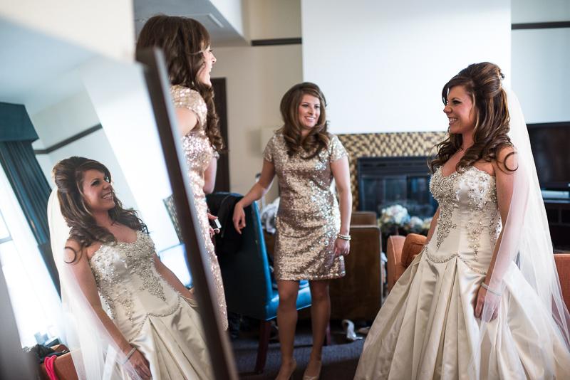 denver wedding photography bride looking in mirror