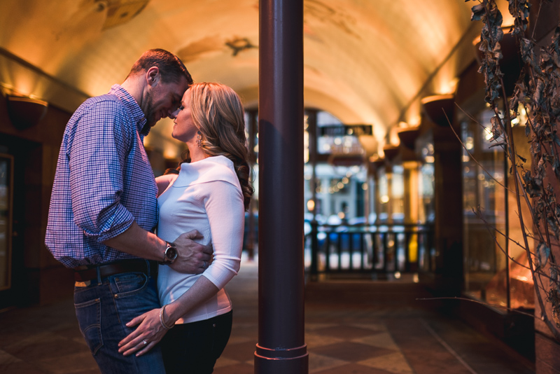 Denver Engagement Photography kissing in arch
