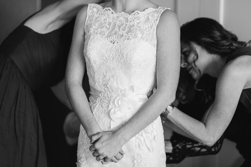 Denver Wedding Photography Cherokee Ranch and Castle bridesmaids help bride get dressed