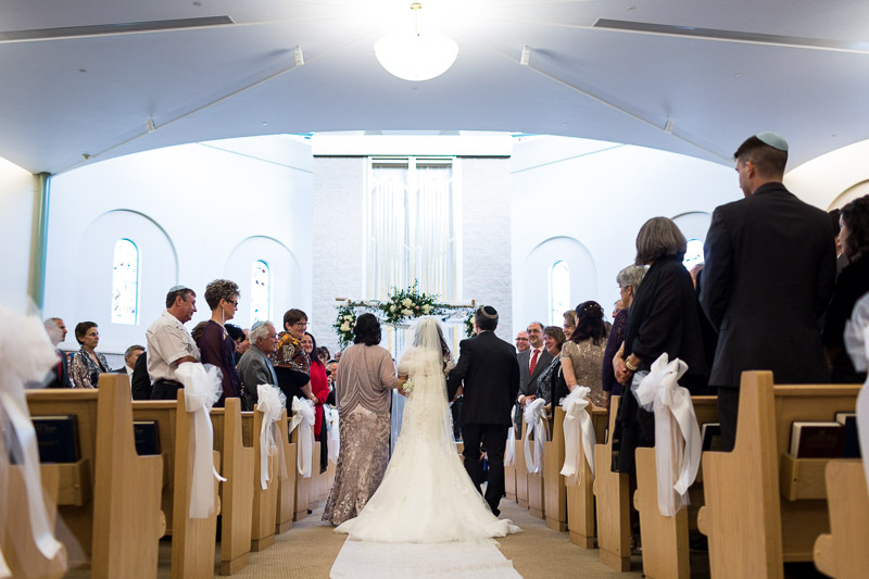 denver jewish wedding photographer bride walking down aisle