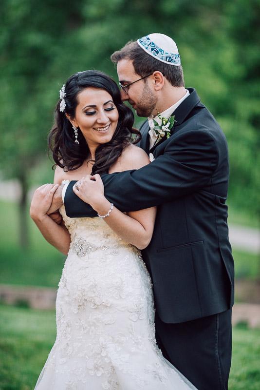 denver jewish wedding photographer laughing couple