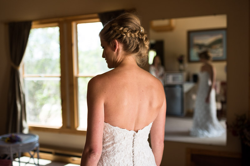 Emily and Ryan Lower Lake Ranch Wedding Photography bride getting dressed