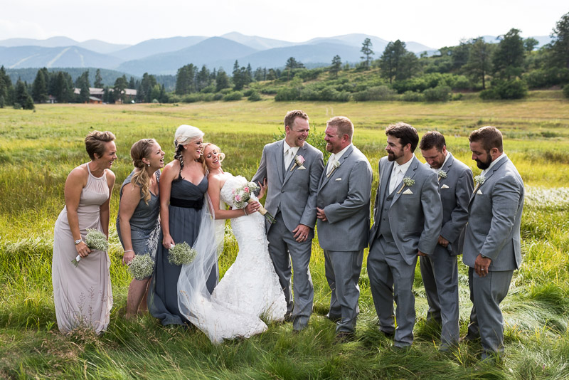 Cuchara Wedding Photographer laughing bridal party in field